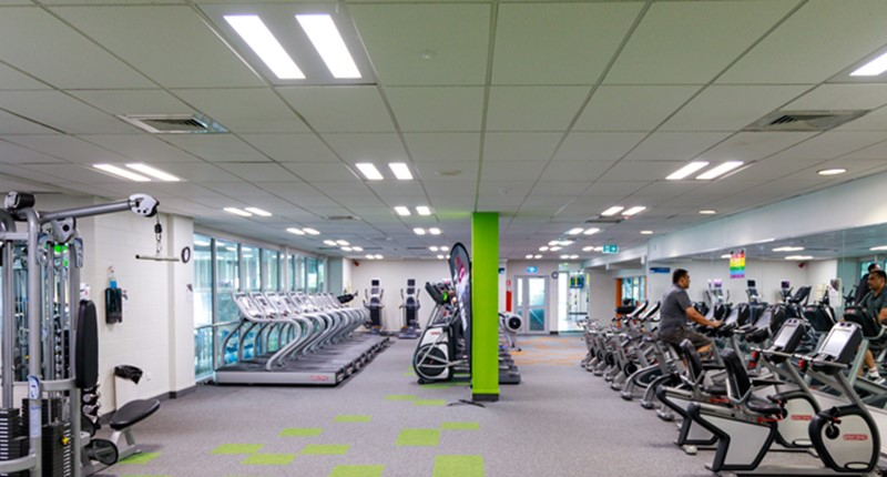 West Wave gym with treadmills, weight machines and stationary bikes.