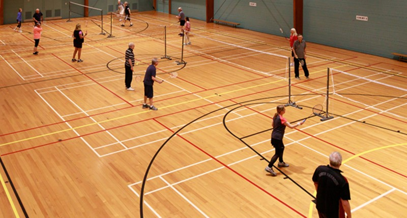 Badminton players in an indoor court