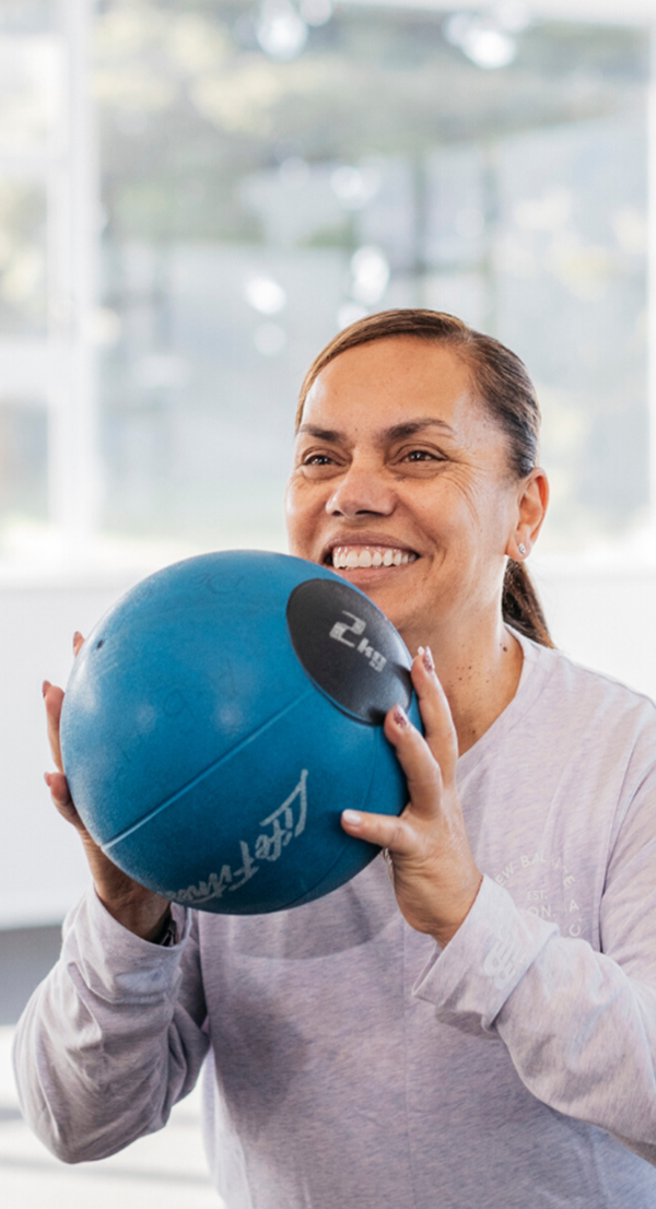 Side image women with medicine ball