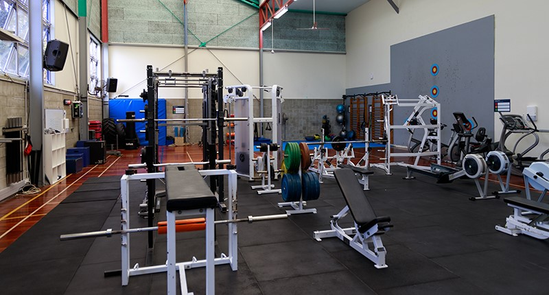Birkenhead gym floor with exercise equipment including weights and rowers