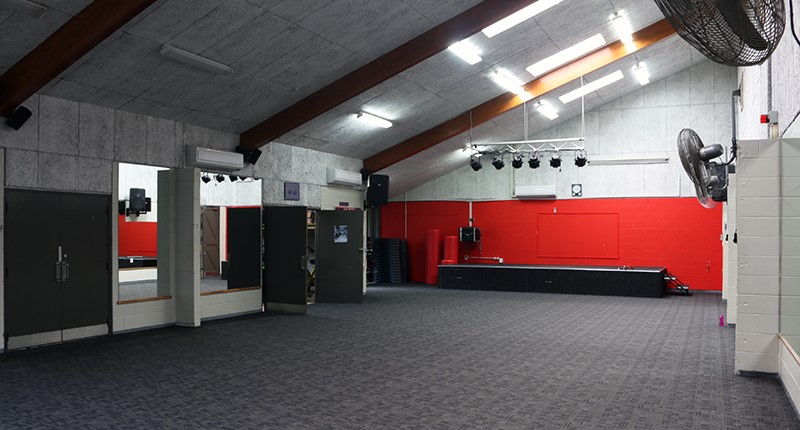 Grey carpeted floor, wall fans and mirrors in the dance studio at East Coast Bays Leisure Centre.