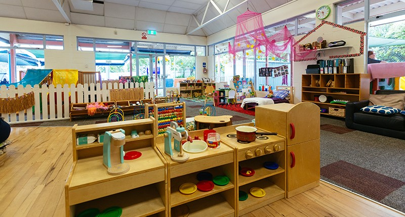howick childcare room with toys and play wooden kitchen and appliances