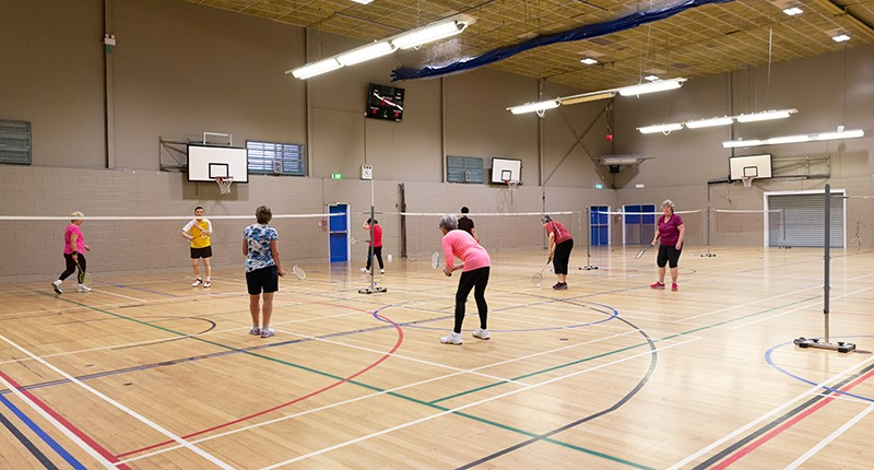 a group of adults playing badminton at the howick leisure centre