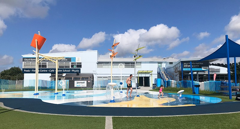 exterior view of the lloyd elsmore pool and splash pad in the foreground