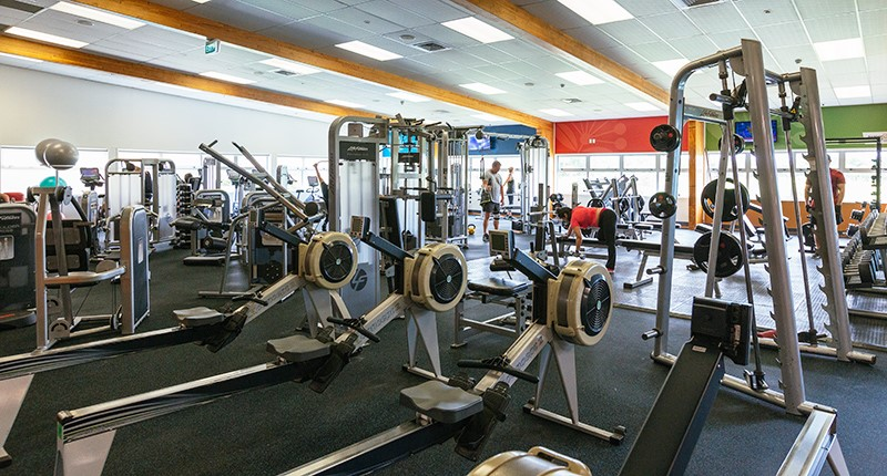image of a fitness centre with rowing machinges and weight machines