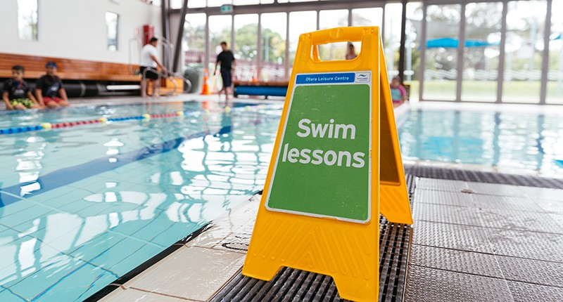 pool with swim lesson sign in foreground