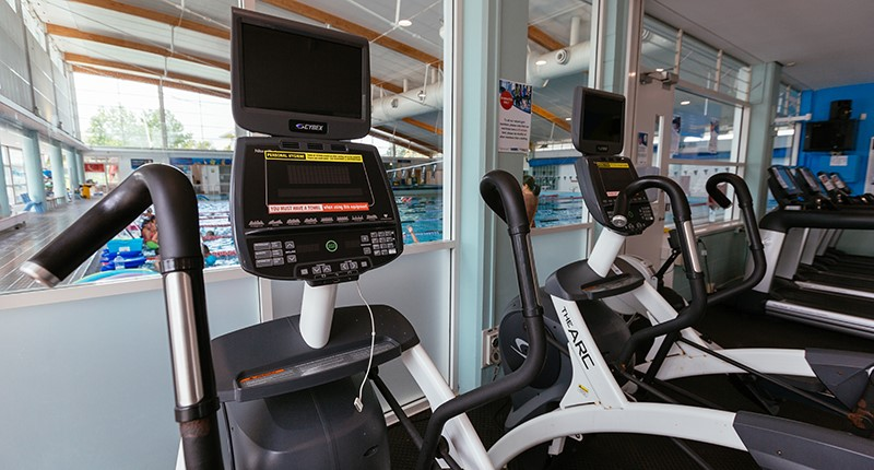 close up of treadmills overlooking the pool hall